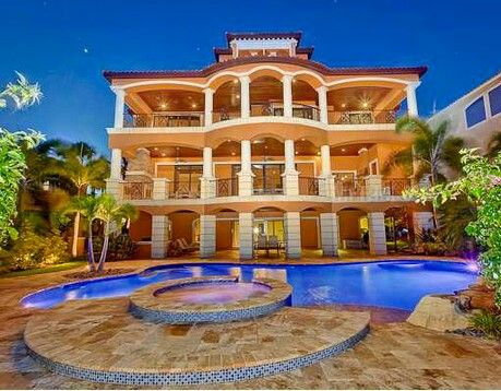 house luxury 3 storey mansion exterior backyard with a wide swimming pool