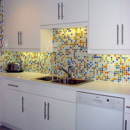 Glass Kitchen Backsplash White Cabinets red, yellow, blue, orange, green, and white tile kitchen backboard