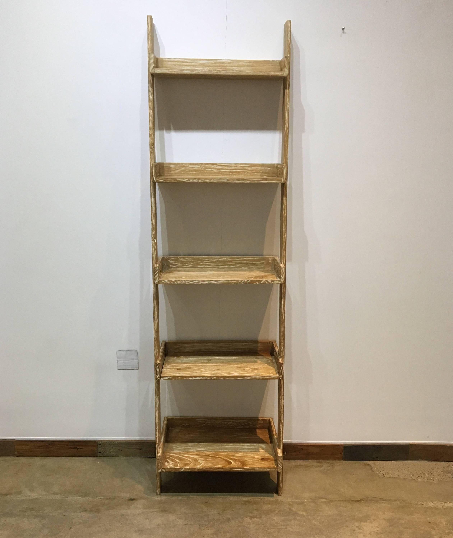 Photo of Modern primitive leaning shelf