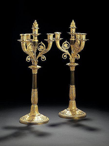 A pair of French Empire gilt and black patinated bronze cand