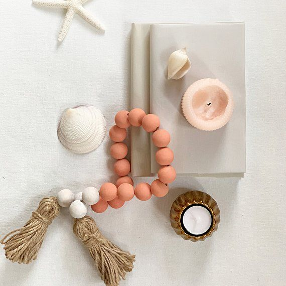 Photo of Living coral coastal decor, farmhouse beads in beach decor, pastel coral wooden bead garland with tassel, boho chic decor, wood bead garland