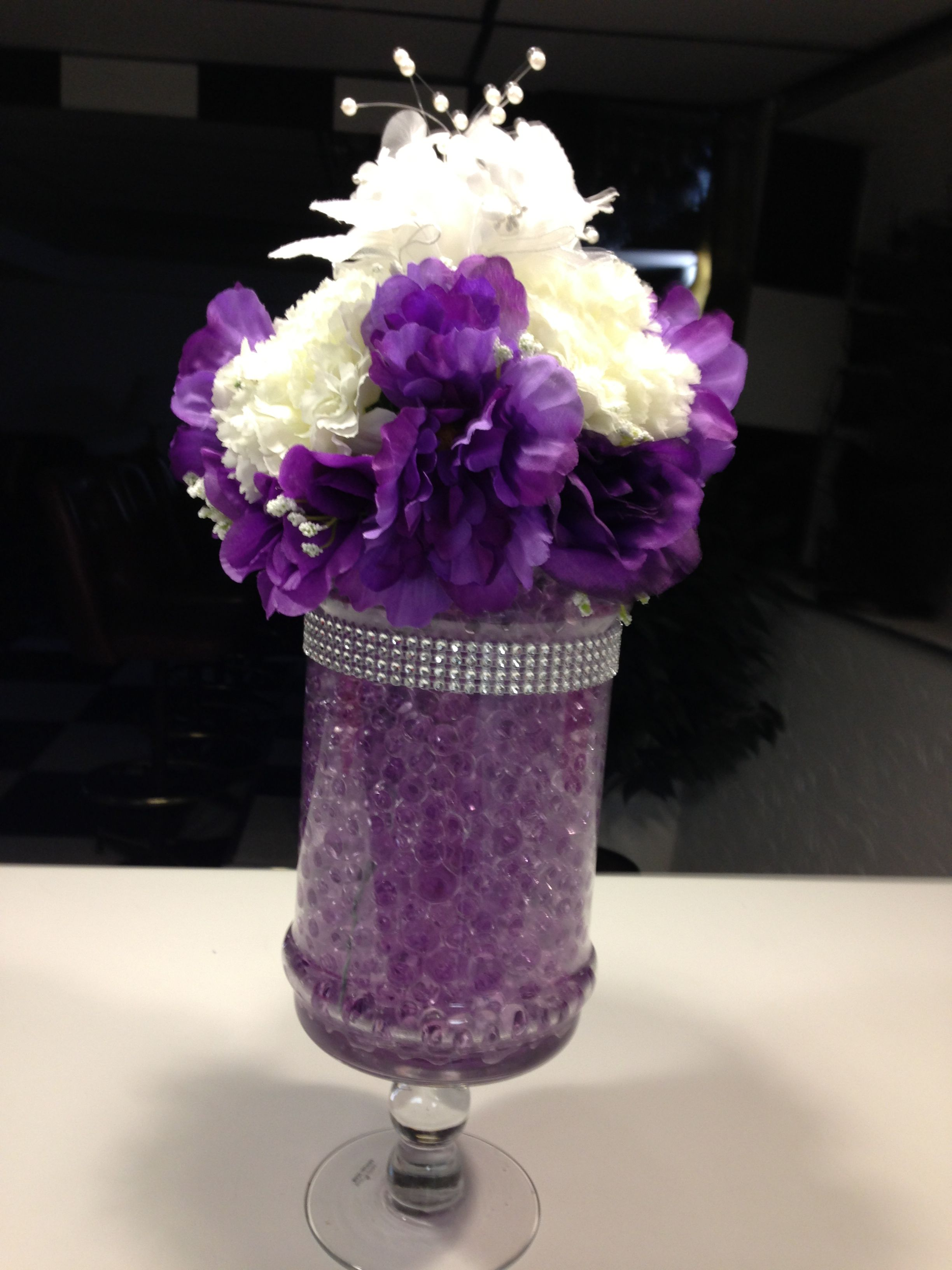 wedding centerpiece with purple water beads, metallic