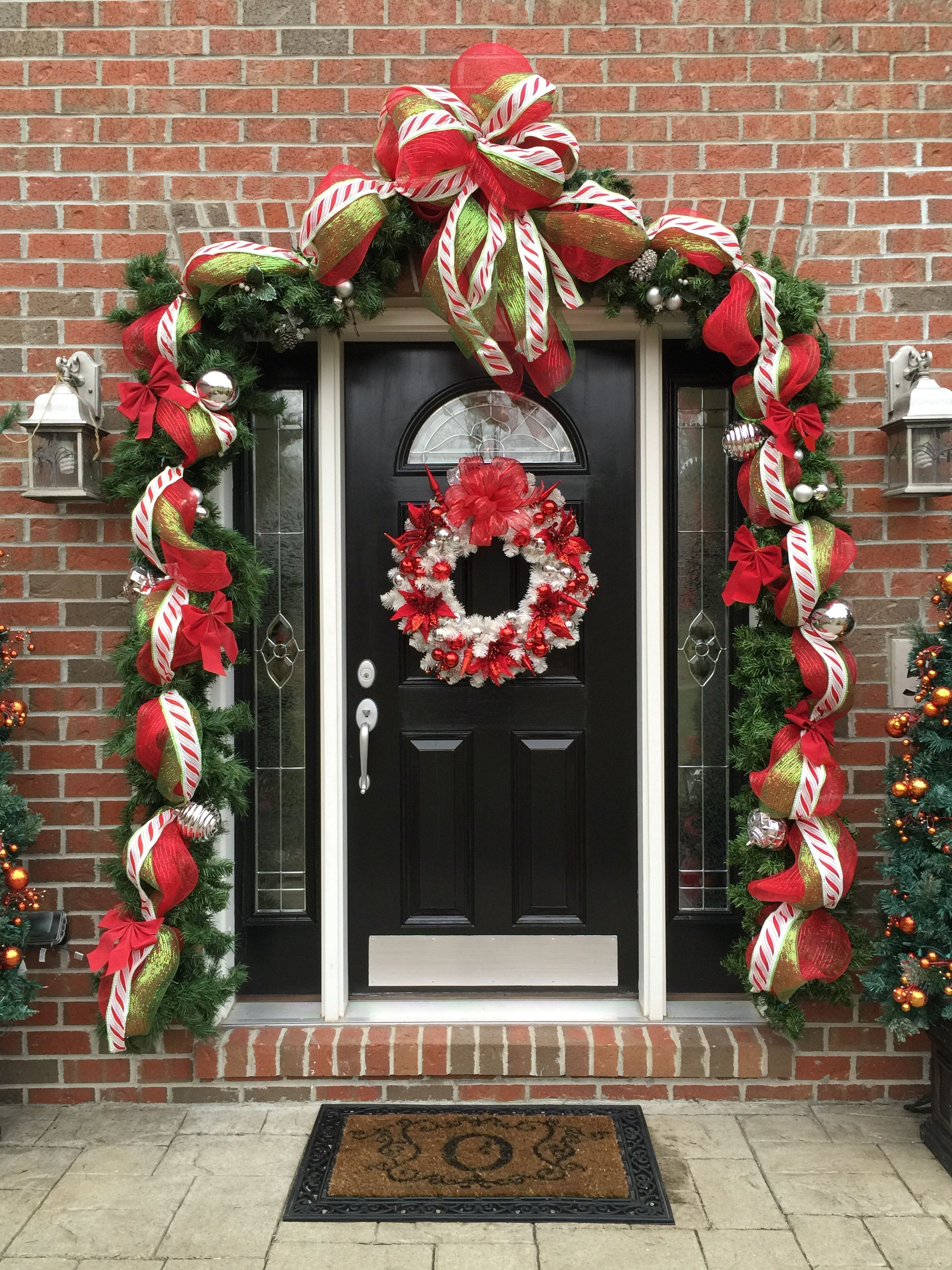 Our addition for the garland on our front door Red mesh green mesh