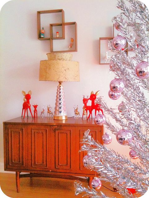 aluminum mid century modern christmas tree with cute retro bambis on a sideboard