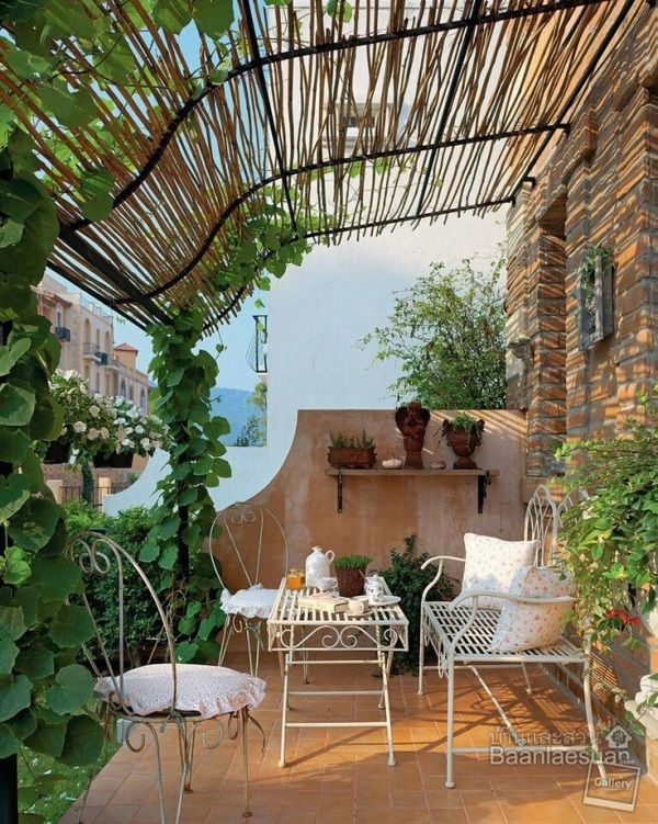 bring a little tuscan flavour to your balcony with a rustic bamboo and metal frame shelter it. Black Bedroom Furniture Sets. Home Design Ideas