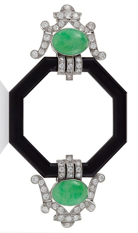 A French Art Deco platinum, diamond, jadeite and onyx brooch, 1920s. The brooch set with 60 old European-cut diamonds, surrounding two cabochon jadeite jades, flanking an onyx octagonal centre. #ArtDeco #brooch