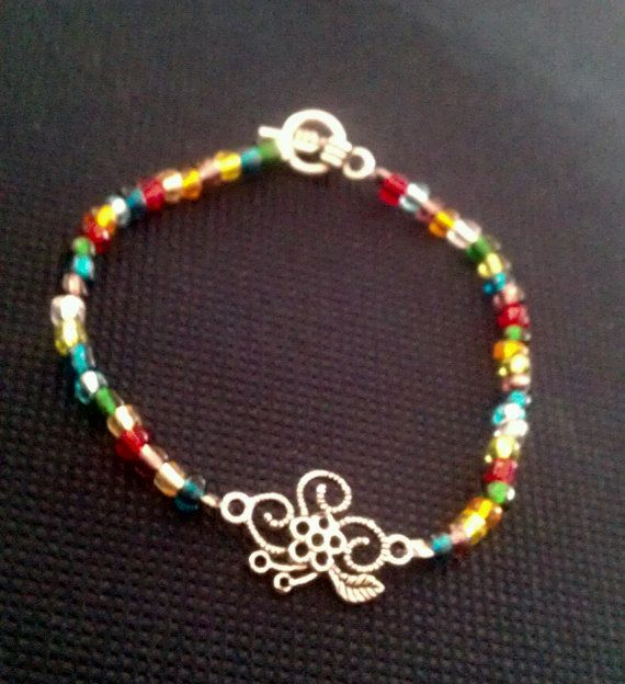 Just listed:  multicolor floral bracelet by ACharmedDelight on Etsy, $10.00