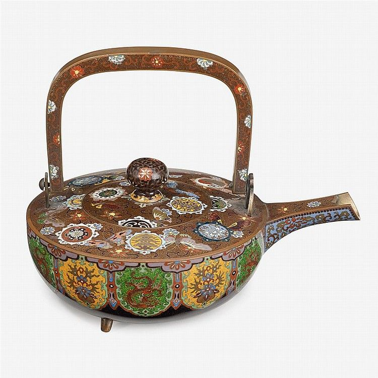 A fine Yasuyuki-style Japanese cloisonné tea kettle  meiji period, 19th century  of flattend circular form, raised on three short legs, decorated to body to show eleven reserves of lotus flower and dragon motifs all around, connected to a thin curved mouth worked with lotus over lavender ground to underside and floral designs over maroon scroll ground to top, cover similarly worked to show butterflies amidst elaborate circular emblems over maroon scroll ground, topped by a knob and handle…