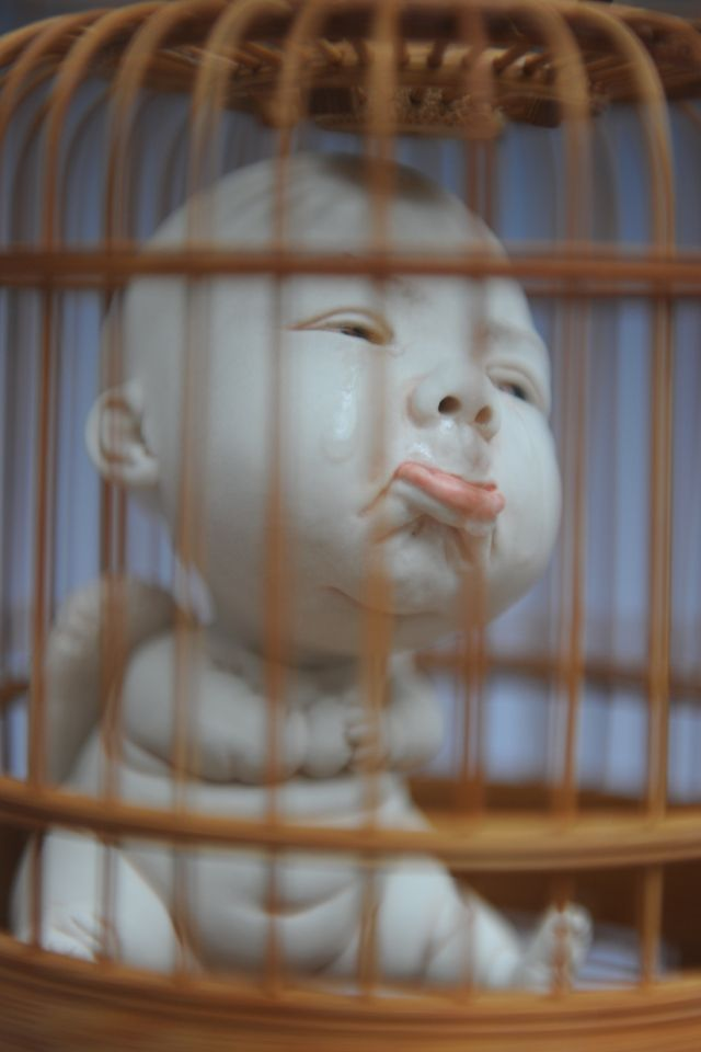 Cupid inside a cage within a bird cage. (Johnson Tsang)