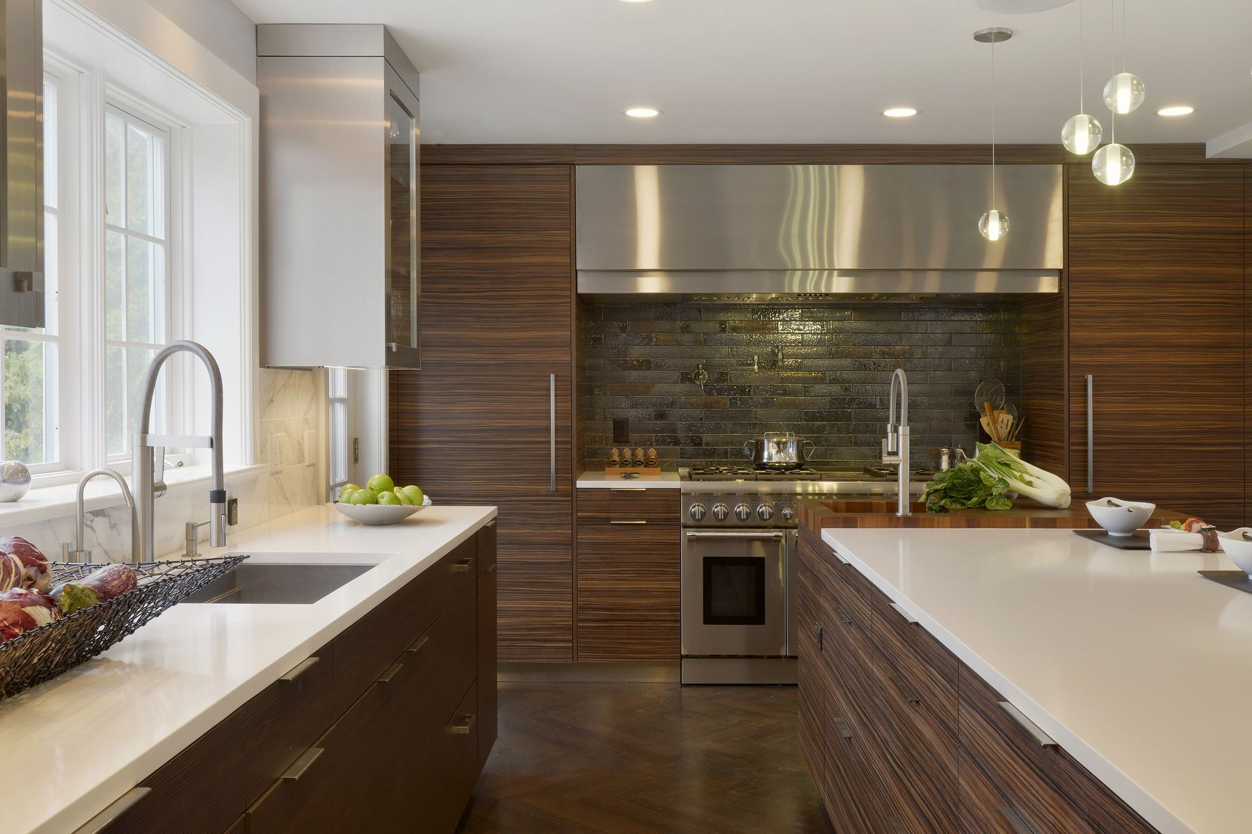 The Large Hearth With Textural Backsplash Is A Focal Point Of This Contemporary Kitchen Contemporary Kitchen Modern Kitchen Design Contemporary Kitchen Design