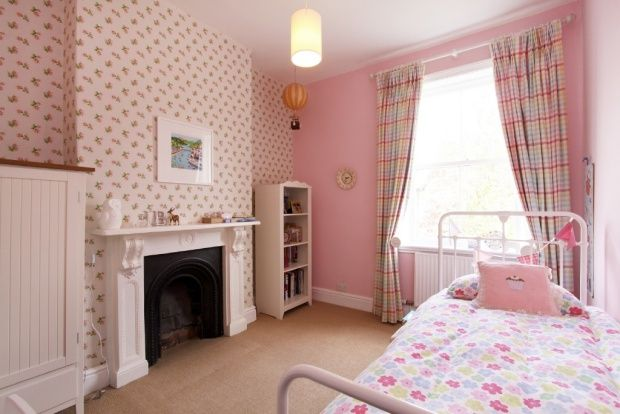 I found this on Rightmove- cath kidston sprig wall paper and white bed gorgeous combo