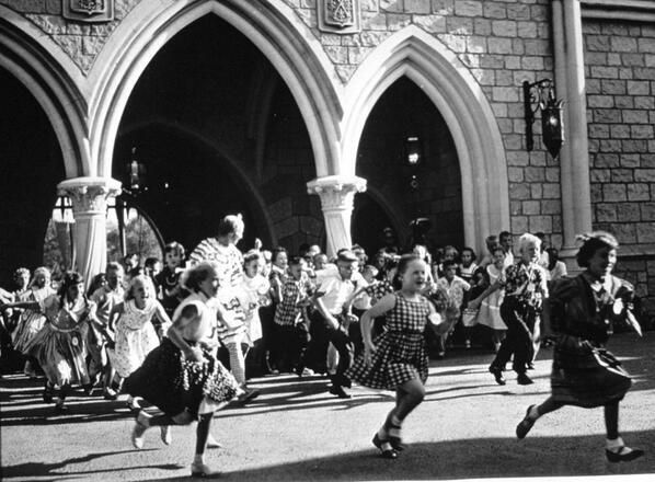 Hundreds of children run through Sleeping Beauty Castle on the opening day of Disneyland, 58 years ago today.