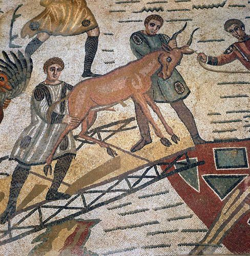 Antelope being loaded for shipping to Rome for games, third to fourth century Roman floor mosaic in imperial villa at Piazza Armerina, Sicily, Italy
