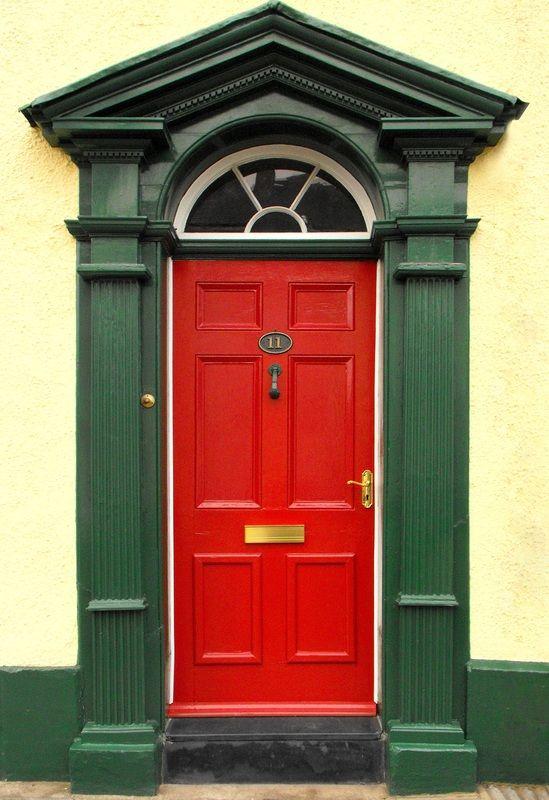 black storm door with red door. (i have a black door that gets too