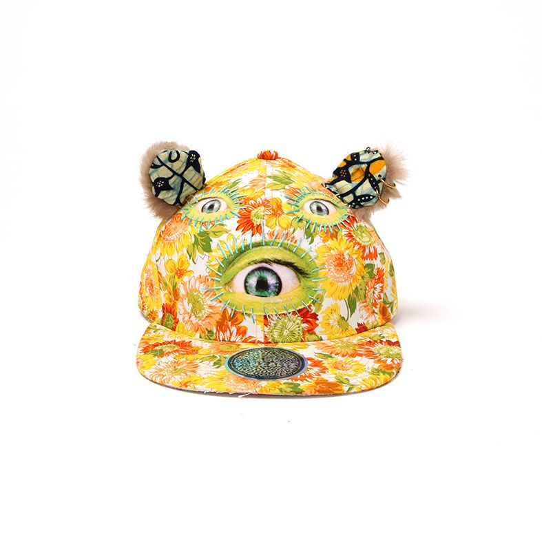 -Hand made  -One of a kind  -Adjustable snapback cap  -Fits all sizes  -Digitally printed cotton fabric patches  -Fluffy embroidered hears at the top  -Comes with reflective Lady Gonzalez sticker  By Lady Gonzalez  SOLD OUT - email store@onlychildlondon.com for customer Lady Gonzalez order