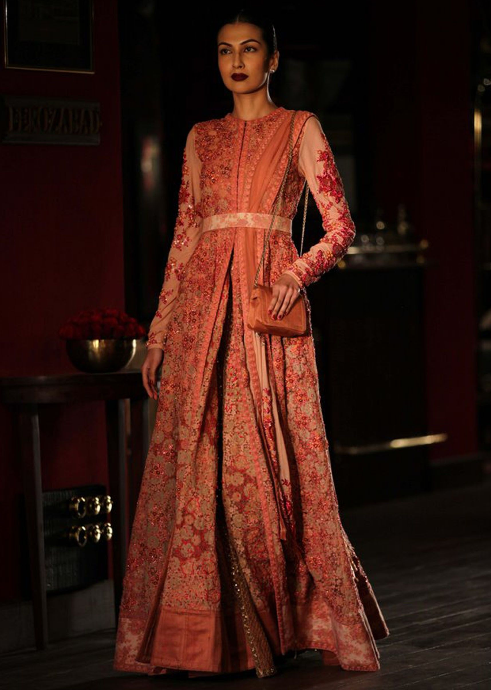 Dress to wear at a wedding  Model waking the ramp wearing Red u Pink Anarkali for sabyasachis