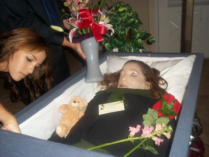jennifer hawkins in her open casket during her funeral