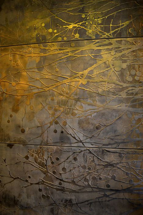 bronze-coloured wall panels at Portman Estates Offices, 38 Seymour Street, London. Mirroring the textures and shapes of an area famously defined by the London planetree, the surface detail designed by Timorous Beasties is part of an installation of bespoke decorative concrete wall panels, manufactured and developed by Graphic Relief and Feilden & Mawson Architects.