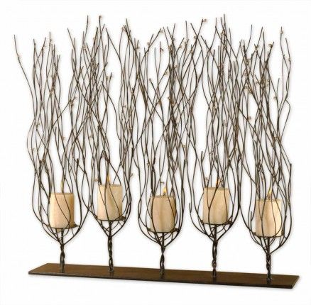 Add a touch of the outdoors with branching, rustic candleholders.