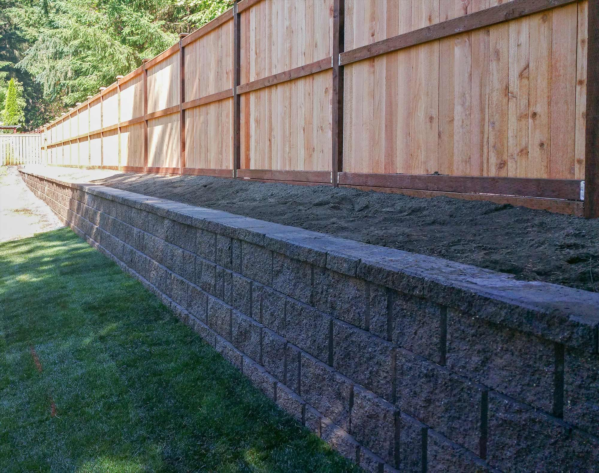 Lacey Retaining Wall And Privacy Fence Landscaping Along Fence Backyard Fences Backyard Retaining Walls