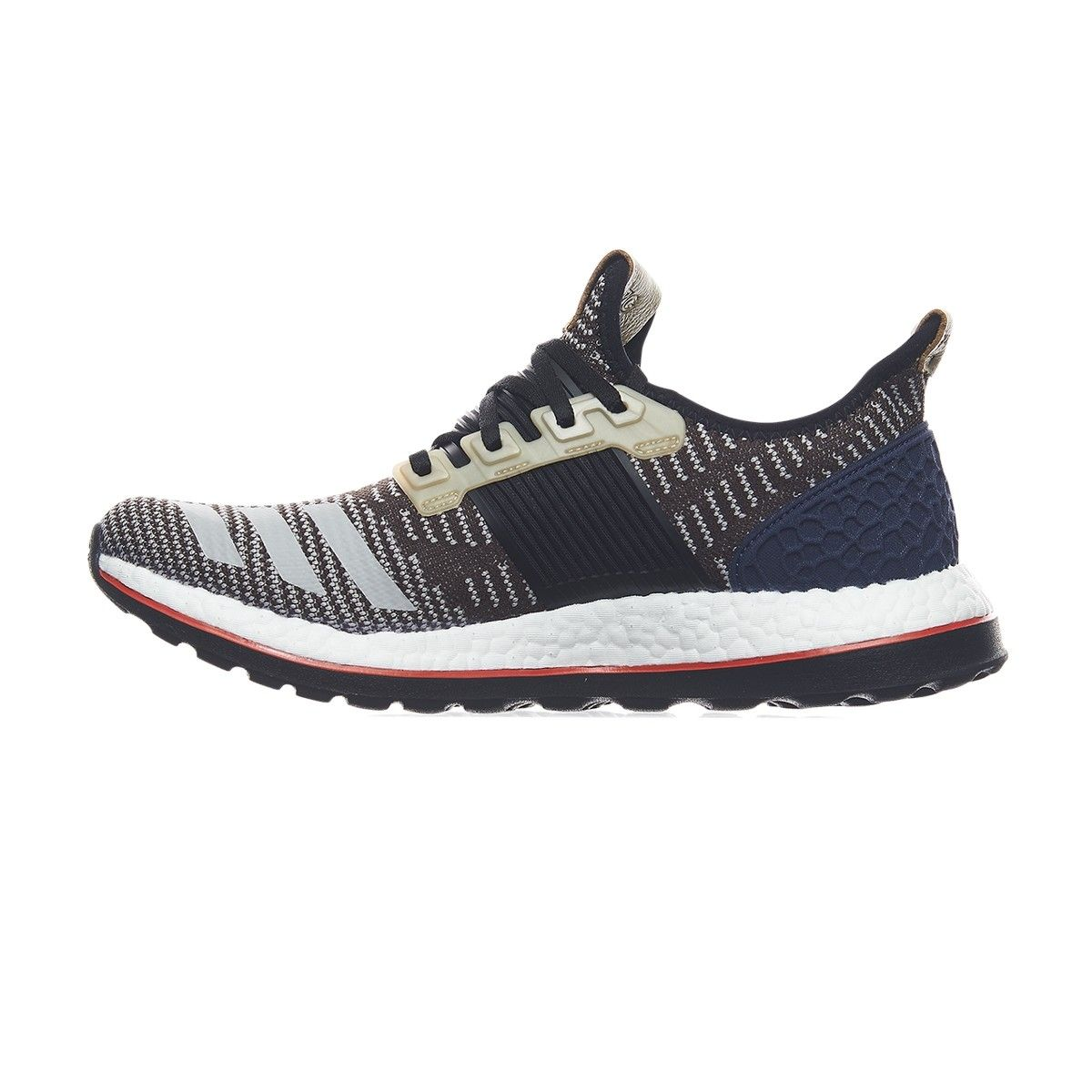 The Kolor x adidas Pure Boost ZG features shades of Navy Blue, Tan, Black  and Red while constructed with Primeknit and leather.
