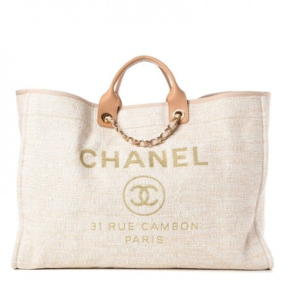 48cefaddd428 This is an authentic CHANEL Canvas Extra Large Deauville Tote in Light Beige.  This stylish