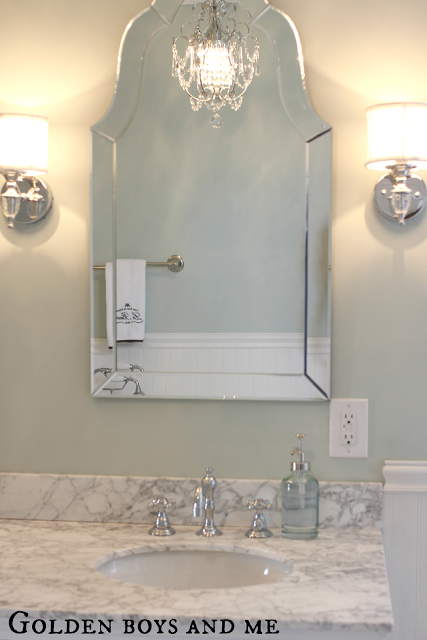 Gorgeous Shaped Mirror In An Elegant Master Bath Featured On