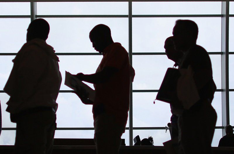 Job applicants reviewing their resumes Joe Raedle\/Getty Images - people who do resumes