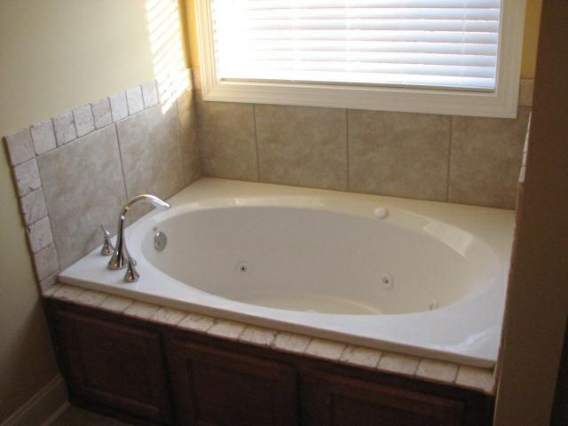 Image Detail for       garden tub with tile surround and tumbled stone  accent. Image Detail for       garden tub with tile surround and tumbled
