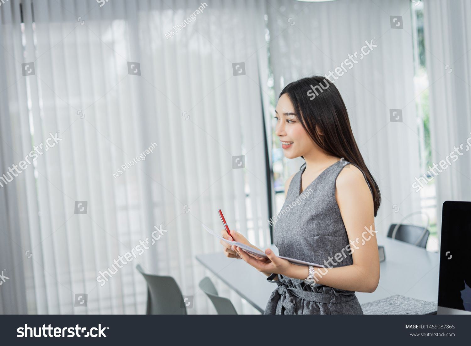 Concentrated young business woman working on her computer in the office.,standing on workplace. #Sponsored , #Affiliate, #business#woman#Concentrated#young