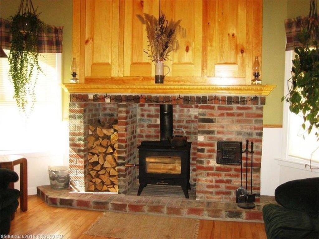Country brick hearth fireplace and wood stove with for Country home and hearth