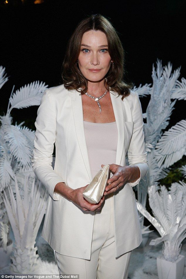 Demure: Also at the event was Carla Bruni, 47 - married to former French  president Nicolas Sarkozy - who looked classy in a white suit and nude vest