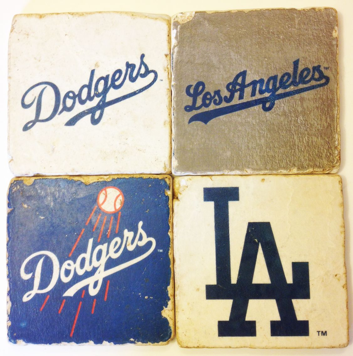 adobe-design.com  Dress up his desk or bar, with Italian travertine coasters from his favorite MLB team.