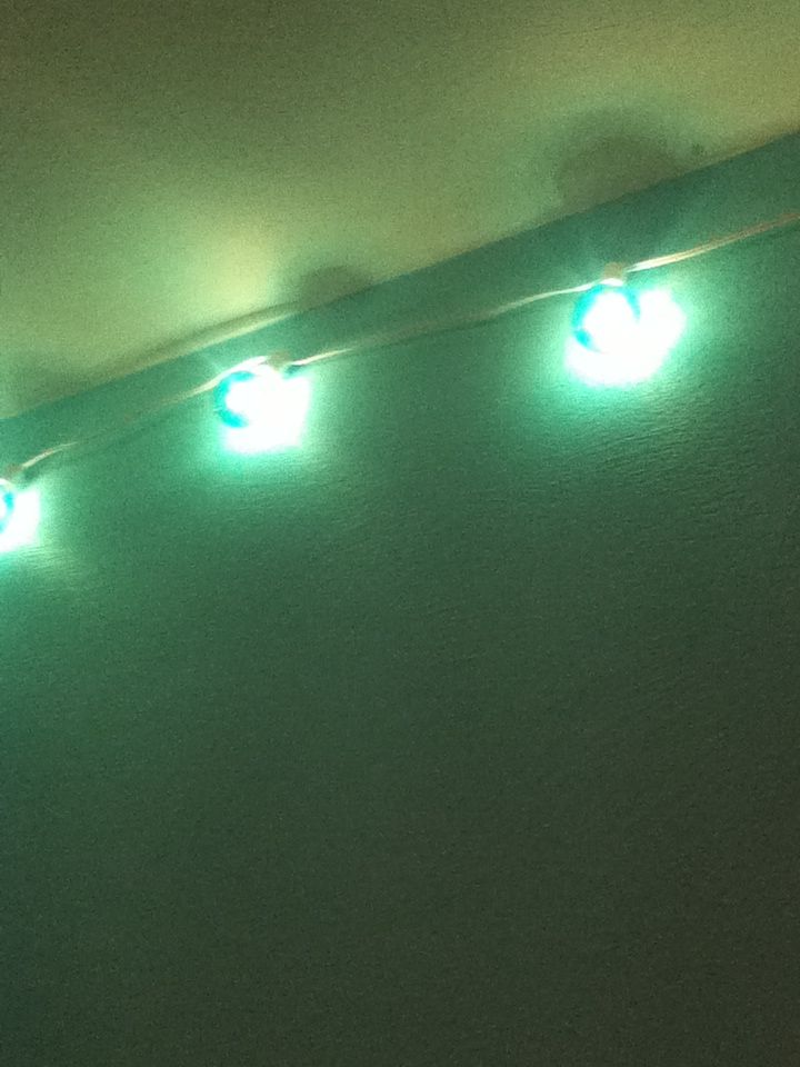 Add cute blue globe Christmas lights across your ceiling to add a