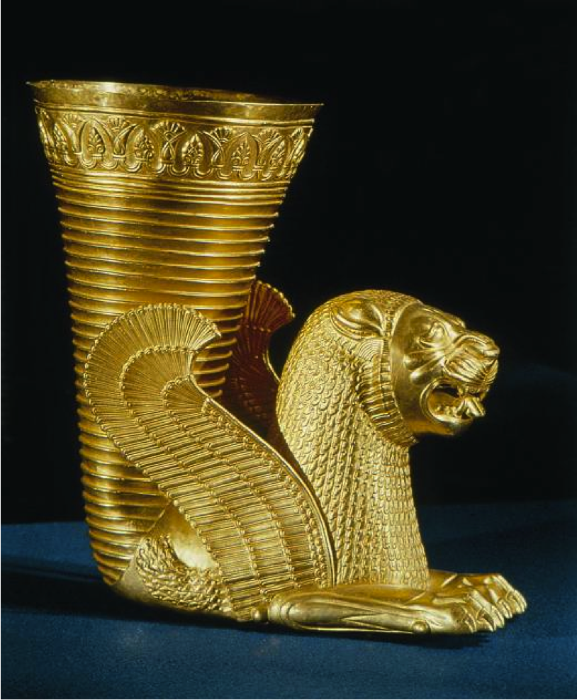 ACHMAENINID PERSIAN METALWORK: Rhyton (Drinking Vessel) Achaemenid. 5th - 3rd centuries BCE. gold. Archaeological Museum, Tehran, Iran. A rhyton is a container from which wines, such as the famous Shiraz wine, were intended to be drunk, or poured in a ceremony. The shape was derived from drinking horns . It is possible they were copied from the Uratians and made popular popular by the Medes .