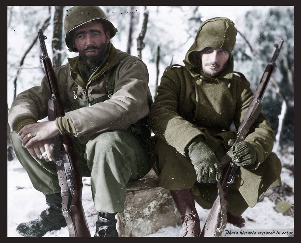 Exhausted riflemen from the 26th Infantry Division, 104th