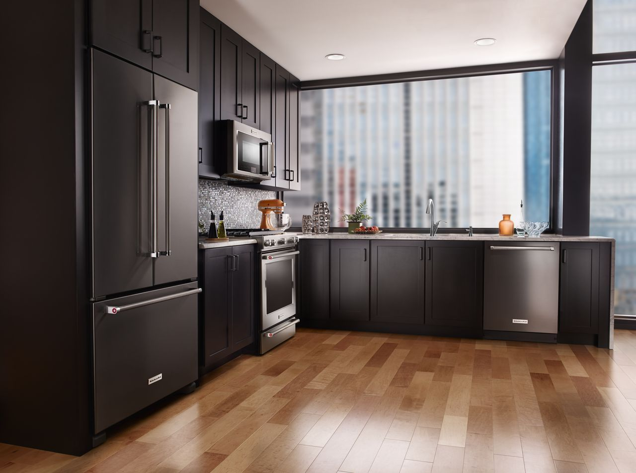 White Kitchen Cabinets With Black Stainless Steel Appliances
