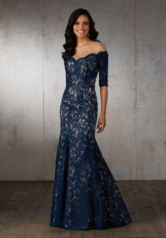 Lace Mother of the Bride Dress with Elbow Length Sleeves. An Illusion Neckline Creates an Off-the-Shoulder Look. Delicare Beading Accents the Bodice and Natural Waist