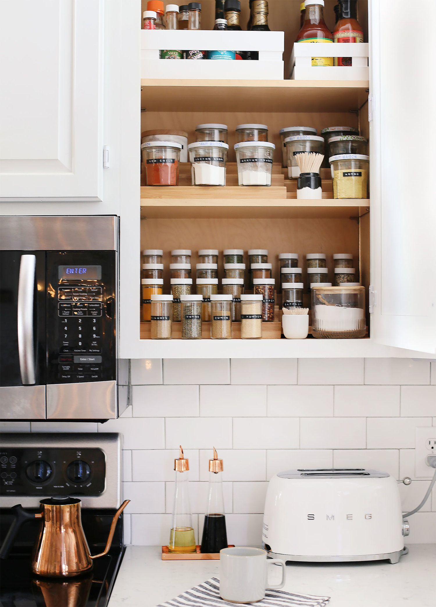 5 Tips To Easily Organize Your Spice Cabinet Sunny Circle Studio Spice Cabinet Organization Kitchen Cabinet Organization Spice Cabinet