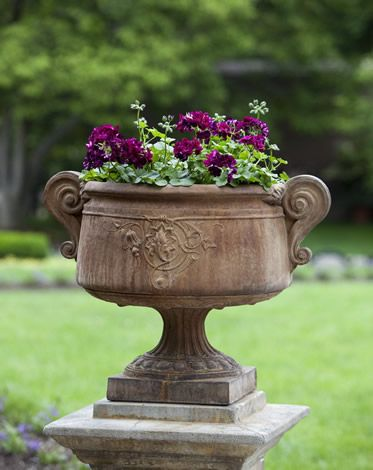 Smithsonian Ivy Urn      Two scrolled accents adorn the sides of this beautiful urn while a foliated centerpiece helps to dress it up even more! The Smithsonian Ivy Urn uses the elegance of ivy vines to create a truly unique piece for your garden or patio.