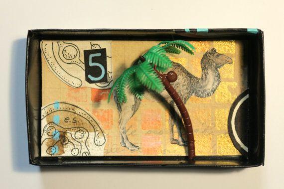 Art:petit diorama réalisé dans une boîte d'allumette.