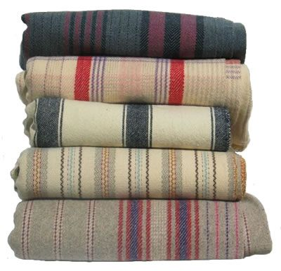 Jen Jones Welsh blankets -Lots of these in her 'utt' farmhouse - http://www.underthethatch.co.uk/dolaucanol