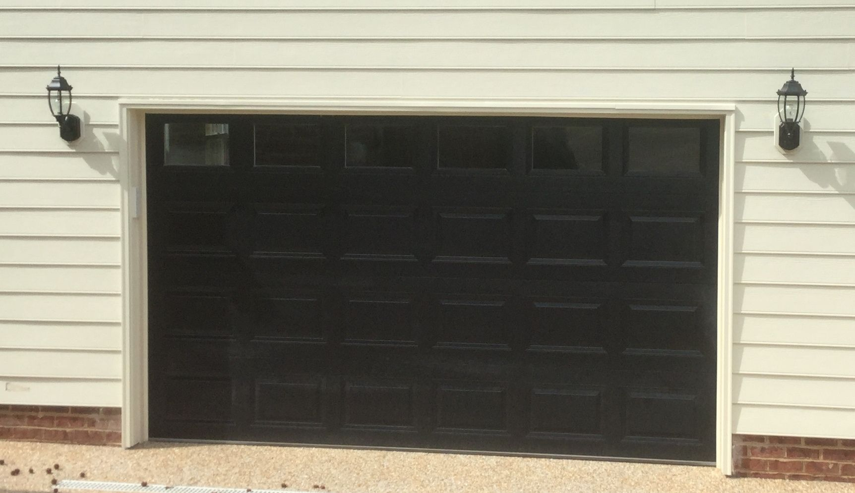 12x7 Model 2216 Raised Short Panel Steel Garage Door Black With Top Clear Glass Installed By The Richmond Sto Home Building Design Garage Doors Building Design