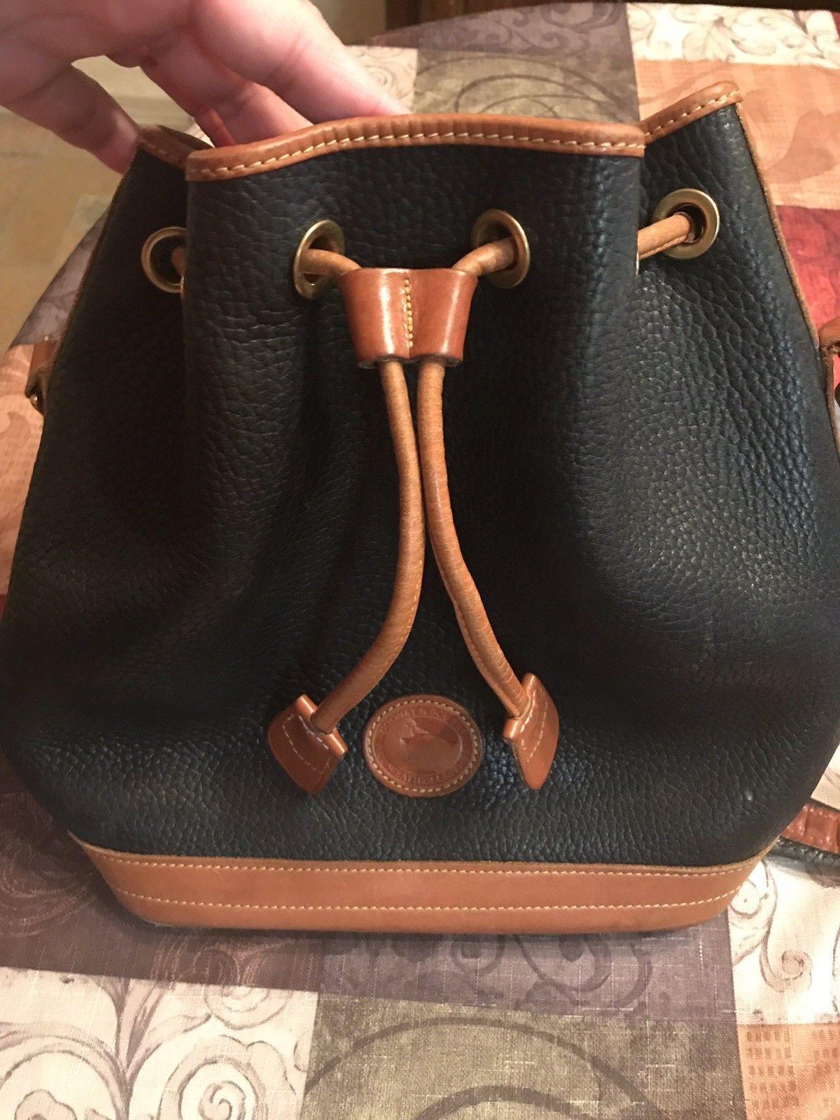 Vintage Dooney and Bourke Teton Drawstring Bucket Bag Black Tan Saddle  Clean.  120.0  dooney 08f094ec058f6