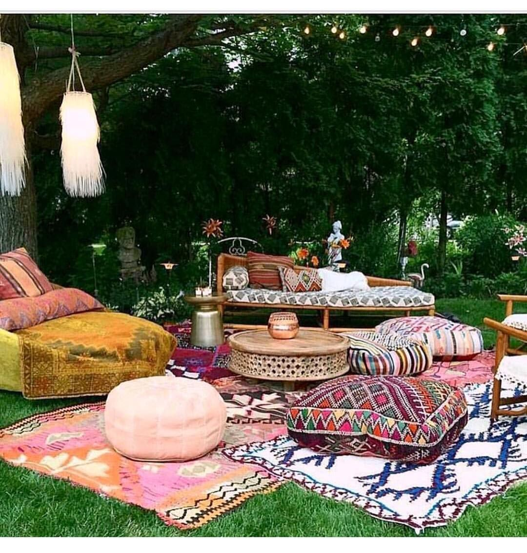 Outdoor Bohemian party with moroccan rugs and textiles, designed ...