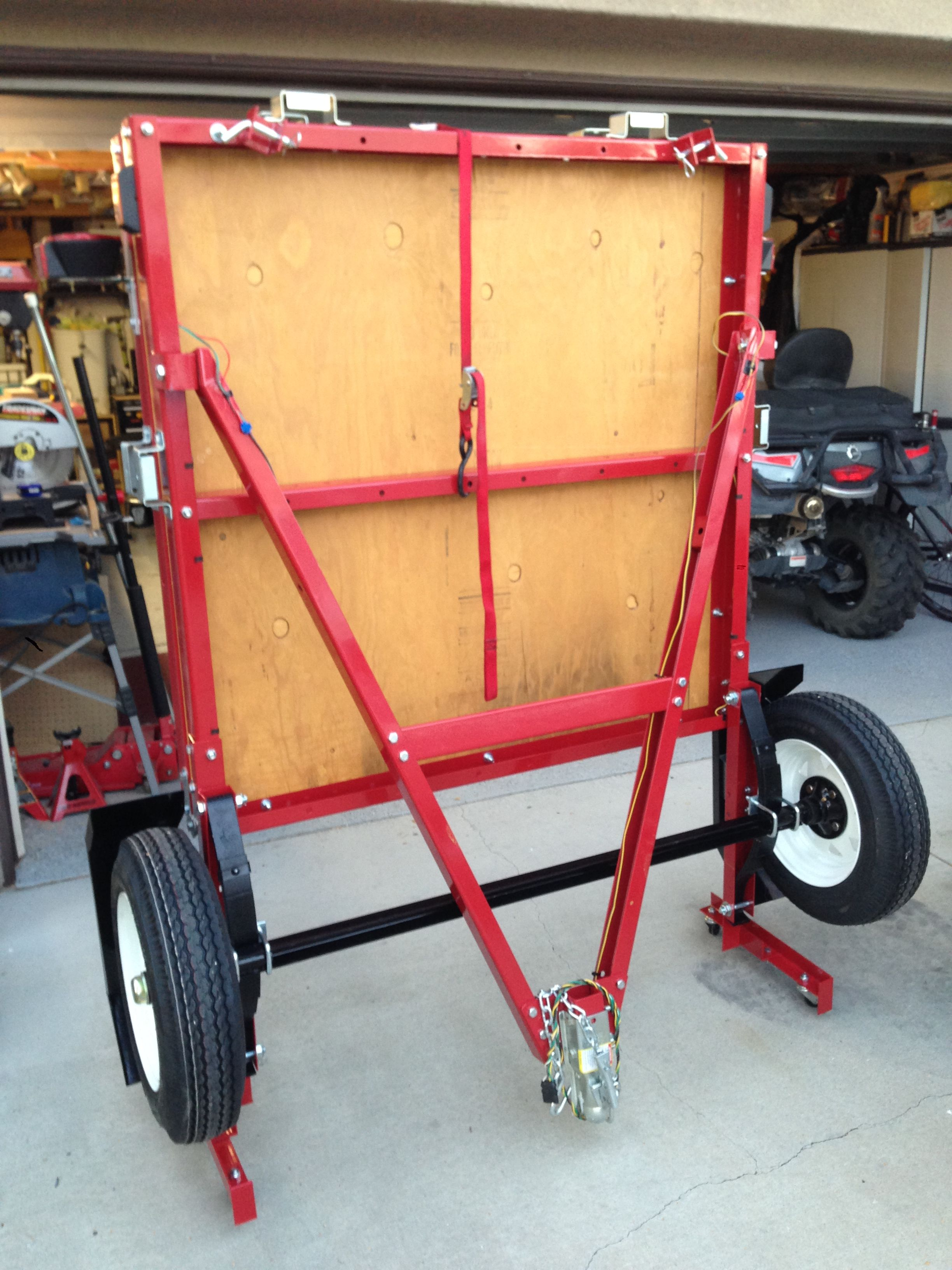 Folding trailer in folded position, ready for storage