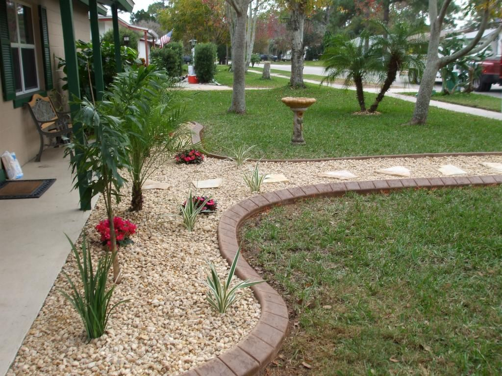 this landscaping looks great  incorporate color shell mulch into your landspacing for some