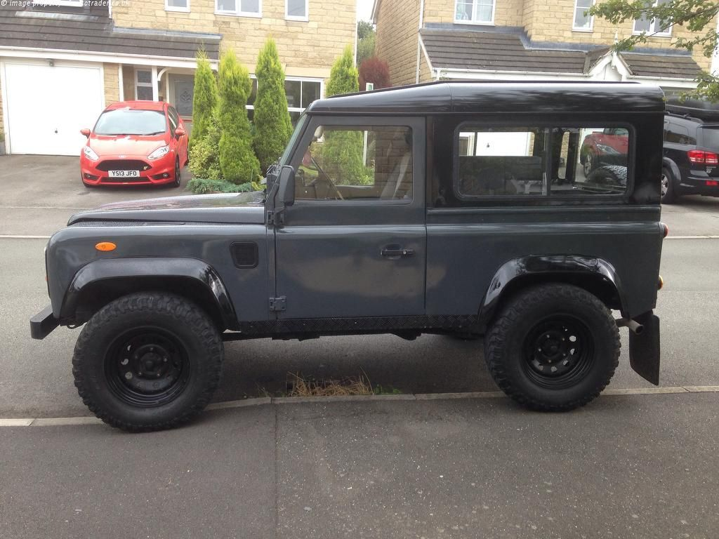 silver black pin defender rover pack and land
