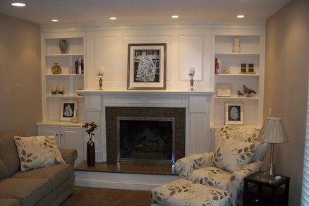 tv above electric fireplace with bookshelves | Fireplace surround ...