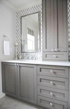 Charming Bathroom With Lattice Tile, Gray Vanity, Crystal Knobs, White Counters,  Chrome Fixtures, Built In Storage Tower